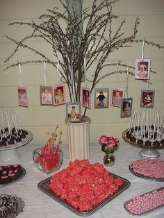 Baby Shower Center Piece - vase holding tree with hanging baby pictures of parents