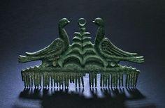 Ornamental comb Etruscan, 500-300BC  Bronze cast Size: 6,5 cm across