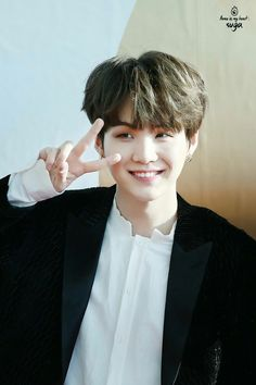 I've been lacking on my suga posts but this is a GREAT pic of him omg XD I love it when his hair is all fluffy like that and I always say this but his smile looks so beautiful all guys and bright happiness ^^