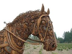 Rusty Horse Head - photo by PNW Gail, via Flickr;  scrap metal draft horse by Dixie Jewett