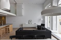 Drak Sofas and Chairs Also Beside Wooden Barstool and Kitchen Room