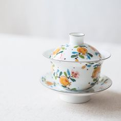 This pomegranate porcelain gaiwan was made by an independent artist in Jing De Zhen. It balances classic elements with a modern stylings and execution. This unique and detailed approach is what made us fall in love with this gaiwan, which holds approximately 145ml of liquid.