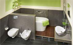 Wand, wechsel Dich! Halbhoch geflieste Wände im Badezimmer lassen mehr Spielraum für Farbwechsel.