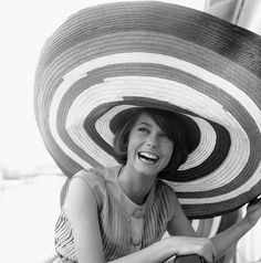 Catherine Deneuve, large hat.