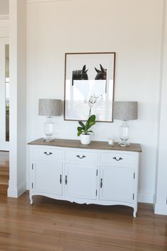 Like the style of this cupboard with timber top, white bottom and curved legs and bottom.Also like the glass lamps and shades,. Home Decor Hooks, Home Decor Bedroom, Living Room Decor, Hampton Furniture, White Washed Furniture, White Buffet, Modern Country Style, Interiors Magazine, Custom Built Homes