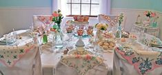 Shabby Chic Tablescape- I love the mason jar glasses, vintage dishes and lovely hankies that your quests can then take home!