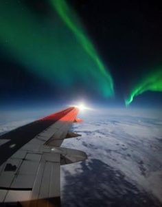 Northern lights and wing of the plane
