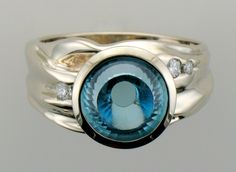 Micky Roof custom Wrinkle Ring in White Gold with White Diamonds and Fantasy Cut Blue Topaz, this is one of my holographic cuts. Gems Jewelry, Jewelry Watches, Silver Jewelry, Fine Jewelry, Unique Jewelry, Jewlery, Luxury Jewelry, Unique Rings, Vintage Rings