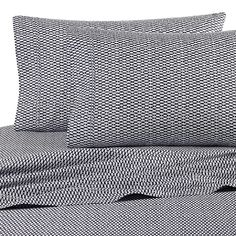 Nautica® Lawndale Queen Sheet Set in Navy  Adorned with a fun ikat print in navy and white, the simplistic sheets are the perfect complements to the calming bedding.