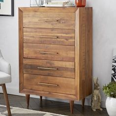 Crafted from reclaimed pine, our Alexa Storage 5-Drawer Dresser imparts sophistication to naturalist style with its gently tapered legs and brass-finished pulls.