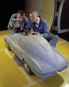 """""""This image wins handily! It's of a 1963 Chevrolet Corvette scale model in the wind tunnel and a Polaroid camera in hand. Enjoy! (Image: www.bentleypublishers.com)"""""""