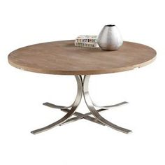 """Distressed driftwood coffee table with a sculpted stainless steel base.   Product: Coffee tableConstruction Material: Stainless steel, oak and oak veneerColor: Distressed driftwoodFeatures:  Heavy, sculpted baseOffers rustic sophistication Dimensions: 16.5"""" H x 35.5"""" Diameter"""