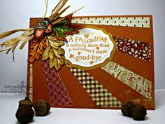 handmade card: Autumn Blessings by Leenda  ... beautiful browns ... sun ray design with patterned paper rays alternating with open space ... montage die cut leaves and layered label with sentiment ... luv it!