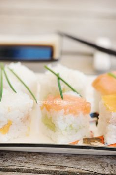 I would definitley buy this!   Cube It! Rice Cube Sushi Maker  It's at amazon.com!