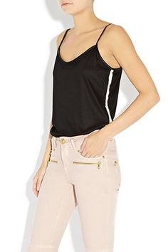 A girl needs her basics and this is a quality jersey vest that your wardrobe cannot be without! Sports luxe at its best.  Available in Black with Nude trim