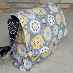 Follow these step by step instructions to make this great bag. Make it in any color or pattern as school bag for a boy or girl!