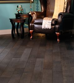 "Charcoal coloured 5"" solid hardwood in library with variation"