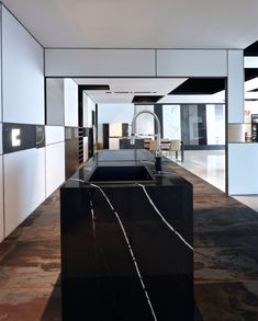 If there is a #TopsOnTop piece in our Valencia Cosentino Center, that is this Silestone Eternal Marquina #kitchen island! What a charmer!
