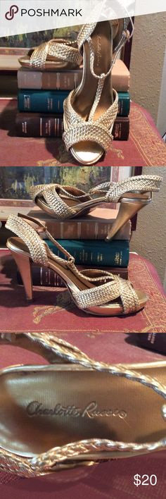 Gold Braided High Heels! Add elegance to any attire with these gorgeous open toe gold braided heels.  Heels are 4 inches.  Strap has stretch to help the shoes fit snug on the top of the feet. Charlotte Russe Shoes Heels