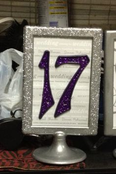 table numbers using photo frames and house numbers....Found on Weddingbee.com Share your inspiration today!