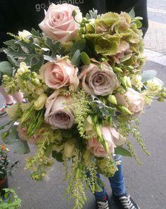 Country style wedding bouquet of hydrangea, sweet avalanche roses, lisianthus, astilbe, metalina rose, stock, eucalyptus, senecio foliage