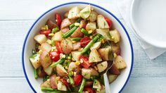 This roasted vegetable potato salad is light and refreshing, tossed in a dill vinaigrette and mixed with fresh green onions and tomatoes for added flavor. It's a fresh alternative to the traditional creamy potato salad.