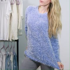 Fuzzy Plush Blue Sweater  You will fall in love with this incredible sweater. Beautiful ice blue color. The fuzzy material is oh so soft and plush. One size fits most. VERY stretchy. 45% acrylic 35% cotton blend 20% cotton. Sweaters