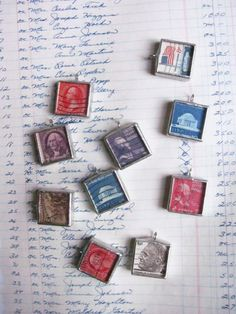 the vintage postage stamps under glass by theoldwhitehouse on Etsy, $20.00