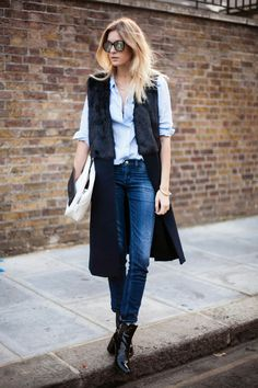 For warm winter days, layer a sleeveless coat over an oxford shirt and jeans.
