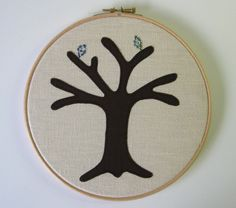 """Cotton anniversary gift -  Liberty fabric. Add a new leaf each year of marriage. Applique tree in 8"""" wooden hoop frame by tailorbirds on Etsy https://www.etsy.com/listing/186816869/cotton-anniversary-gift-liberty-fabric"""