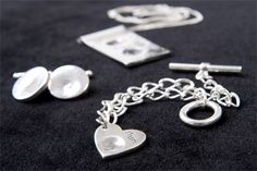 Valentine or Mother's Day, this heart shaped silver fingerprint charm covers both!  www.treasure-forever.co.uk