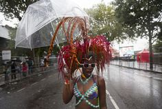 A performer poses as she takes part in the Notting Hill Carnival in west London August 25, 2014 REUTERS/Neil Hall