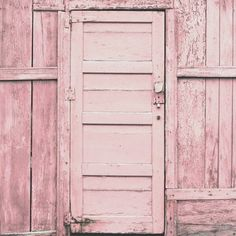 Pink shabby painted door.