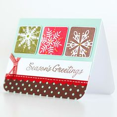 DIY Season's Greetings Christmas Card - stamp snowflake image (or whatever you want to use)m stamp or write (or use stickered letters) to write a Christmas-y sentiment, scallop the edge, some ribbon and voila!)