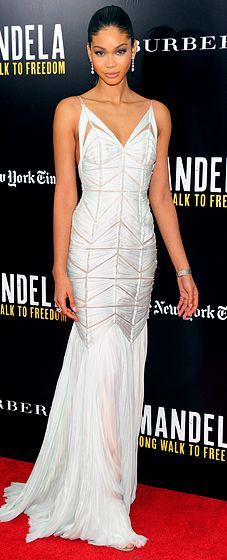 Chanel Iman looks stunning in a white, silk and chiffon J. Mendel resort 2014 gown with cutouts to accent to her svelte figure at a Mandela screening.