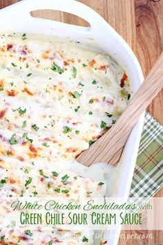 White Chicken Enchiladas with Green Chile Sour Cream Sauce Recipe | These enchiladas are so quick and easy to put together, especially with leftover chicken or a rotisserie chicken from the grocery store. Even better, they have a homemade sauce–no canned soups here!