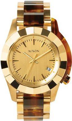 Gold Nixon watch.  http://www.swell.com/Womens-Holiday-Gift-Guide/NIXON-MONARCH-WATCH-2?cs=GO