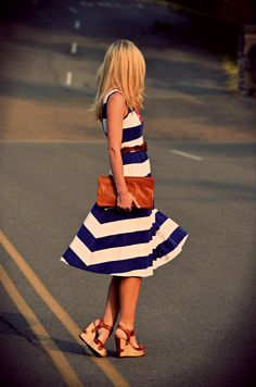 striped navy dress, neutral wedges, tory clutch... fabulous outfit