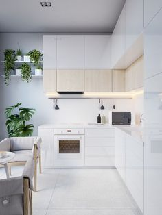 a small modern kitchen nook with cabinets covered with light colored wood for giving it a textural look