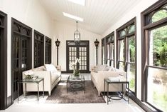 What makes this porch so inviting is the natural light coming from above. The dark grey framework is also very cool.
