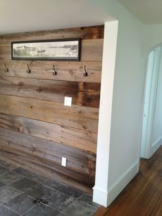 could just do a wood wall too... With a small bench and hangers above! LOVE IT