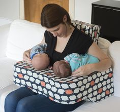 Real life mummy with borrowed babies demonstrating the Piglet Pillow. By the time I received my perfect product Peanut & Piglet were too big! Every thing you need in a twin breastfeeding pillow.