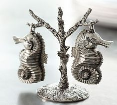 SO. Cute! Beautiful, functional table pieces like these seahorses give you a great 'bang for your buck' as they perform their given job, and add decorative accents to your table setting . Seahorse Salt & Pepper Shakers #potterybarn