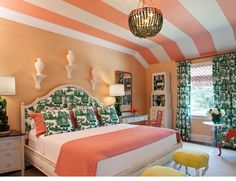 I love the peach walls, the light floor, the coral and white striped ceiling (for those who don't like accent walls, I suggest a cool mural on the ceiling), and the dark green decor to switch it up. 10/10 Lovely, girly room!