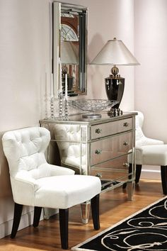 Vignette... love the mirrored dresser and white tufted side chairs