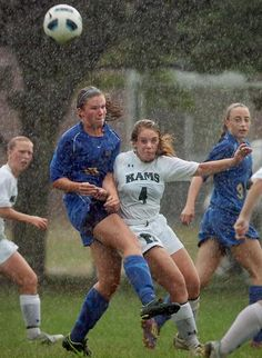 Norwell's Grace Gunning heads the ball away from Marshfield's Colleen Simms (4) during a girls soccer game at Marshfield, Tuesday, Sept. 4, 2012. Amelia Kunhardt/The Patriot Ledger