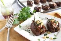 Eggplants stuffed with goat chees, Sundried tomatoes and pine nuts! So delicious I may cry.