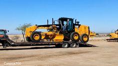 Unloading a NEW CAT 140M SERIES 2 GRADER