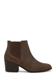 A pair of faux leather Chelsea boots featuring an almond toe, a faux wooden stacked heel, and elasticized side panels.