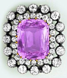 Precious pink topaz, diamond, silver and gold brooch.